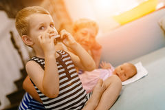 Cute toddler learning to play harmonica Royalty Free Stock Images