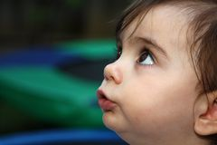 Cute toddler looking up. With her big eyes stock image