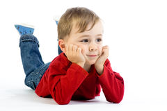 Cute toddler lying on floor Stock Image