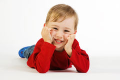 Cute toddler lying on floor Stock Photography