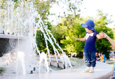 Cute toddler near the fountain Stock Photos