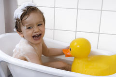 Cute toddler playing in a bathtub Royalty Free Stock Photo