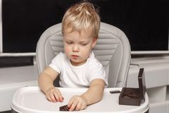Cute toddler playing domino. concept of early child development royalty free stock images