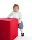 Cute toddler playing with a red cube Stock Photography