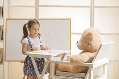 Cute toddler playing teacher role game Stock Photography