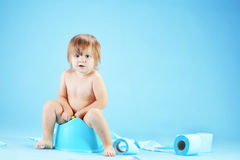 Cute toddler on potty chait Stock Photos