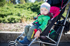 Cute Toddler in pram on a walk Royalty Free Stock Images