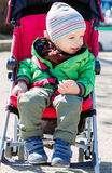 Cute Toddler in pram on a walk Royalty Free Stock Photo