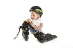 Cute toddler with rollerskates Royalty Free Stock Photography