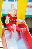 Cute toddler on slide. On the playground Stock Images