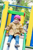 Cute toddler on slide. On the playground Stock Photos