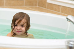 Cute Toddler Smiling satisfied from the Bath Tub Royalty Free Stock Photography