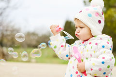 Cute toddler with soap bubbles Royalty Free Stock Images