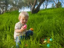 Cute toddler studying Easter eggs Royalty Free Stock Photos