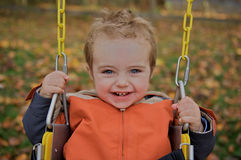 Cute toddler on a swing. Stock Image