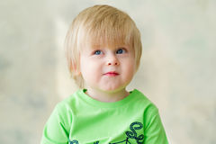 Cute toddler thinking. Portrait of an adorable blond kid looking up Royalty Free Stock Photography