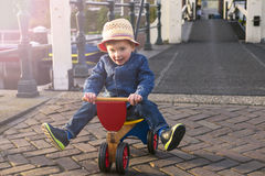 Cute toddler on a tricycle Royalty Free Stock Images