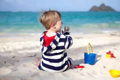 Cute toddler on a tropical beach royalty free stock photos