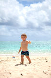 Cute toddler on a tropical beach stock photo