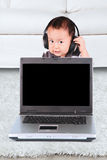 Cute toddler using headphone Stock Photography
