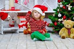 Cute toddler wearing Santa Claus hat Royalty Free Stock Photography