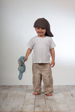 Cute toddler. Young toddler boy with hat holding his favorite toy Royalty Free Stock Photos