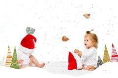 Toddlers in santa hats. Cute toddlers in santa hats isolated on white stock photos