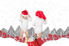 Toddlers in santa hats stock photos