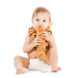Cute todler eating long bread Stock Images