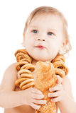 Cute todler eating long bread Royalty Free Stock Image
