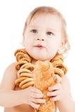 Cute todler eating long bread Royalty Free Stock Image