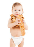 Cute todler eating long bread Royalty Free Stock Images