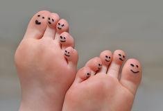 Cute Toes. Little toes with smiley faces Royalty Free Stock Photos