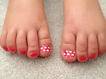 Cute toes. Red Toddler toes with hearts Royalty Free Stock Images
