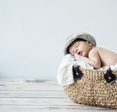 Cute tot sleeping in a basket Royalty Free Stock Photography