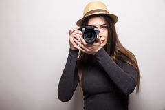 Cute tourist girl taking a photo with a camera Royalty Free Stock Photos