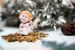 Cute christmas angel and fir con. Beautiful new years composition. stock photography