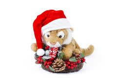 Cute toy tiger with Christmas wreath Stock Photos