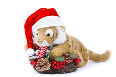 Cute toy tiger with Christmas wreath Royalty Free Stock Photos