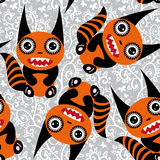 Cute tsartoon orange monster with a striped tail seamless pattern Royalty Free Stock Photos