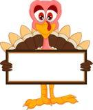 Cute turkey cartoon with blank sign Stock Photos
