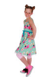 Cute Tween Girl. Cute, freckled tween girl in bright, colorful 50's style dress, against a white background Royalty Free Stock Photography