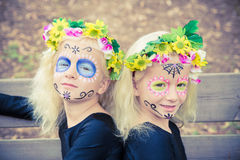 Cute twin girls with sugar skull makeup Stock Photo