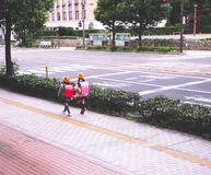 Cute Twin Japanese Student Girls. Back View of Japanese Student Girls wearing backpack on the way to school stock images