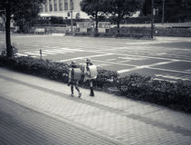 Cute Twin Japanese Student Girls. Back View of Japanese Student Girls wearing backpack on the way to school royalty free stock image