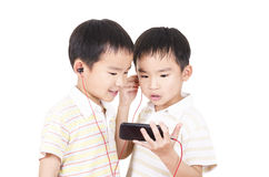 Cute twin listen to music Stock Images