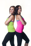 Cute twin sisters facing back to back Stock Photography