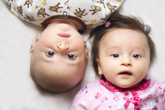 Cute twins, a boy and a girl. This is a picture of fraternal twins, a boy and a girl, 3 months old stock image