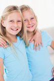 Cute twins embracing each other Stock Photography