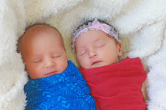 Cute twins sleeping. Together, these are a boy and a girl stock photos